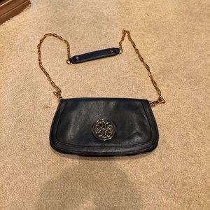 Tory Burch black/gold handbag.
